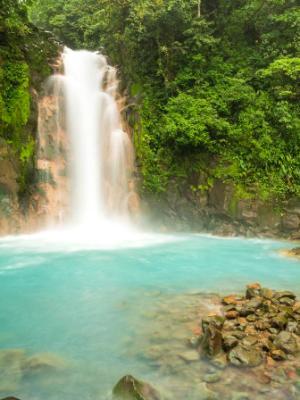 Rio Celeste Waterfall and Sulphurous Rocks